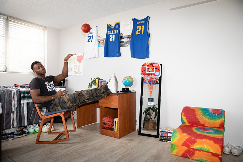 Rollins basketball player, Jakobi Bonner shoots a basketball in his residence hall.