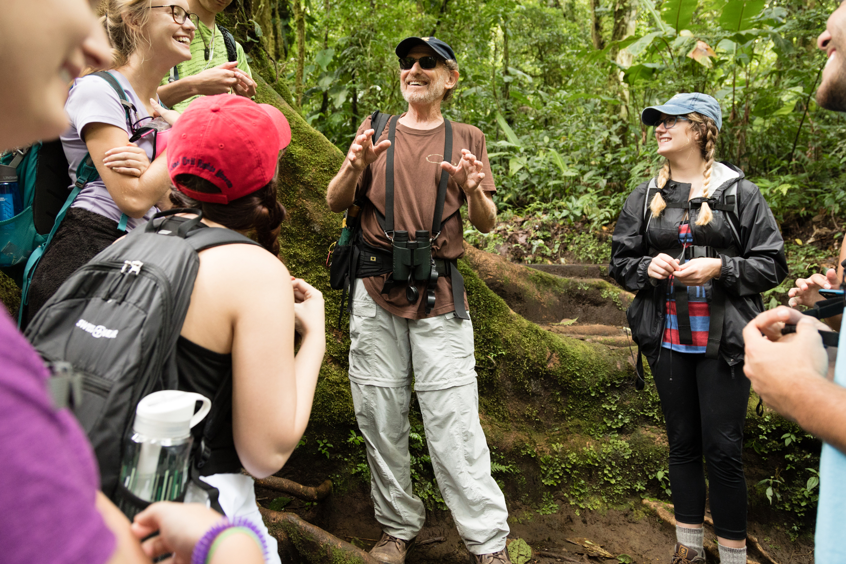 Professor discusses with students in a rainforest during a study abroad program in Costa Rica.