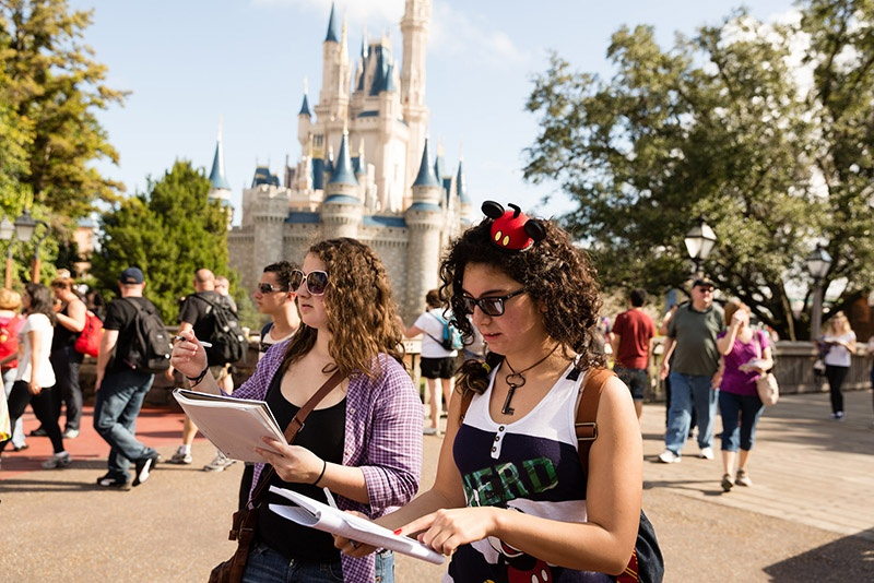 College students work on a project at Disney World's Magic Kingdom.