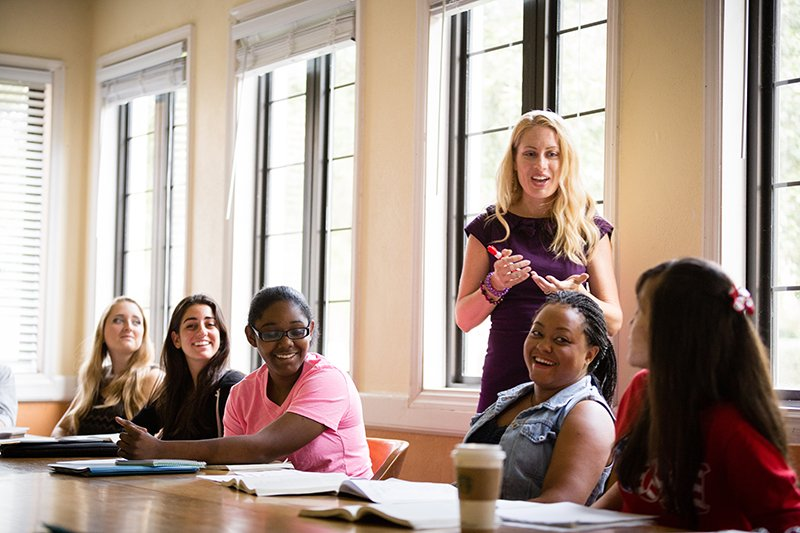 Professor engages a group of students in a class discussion.
